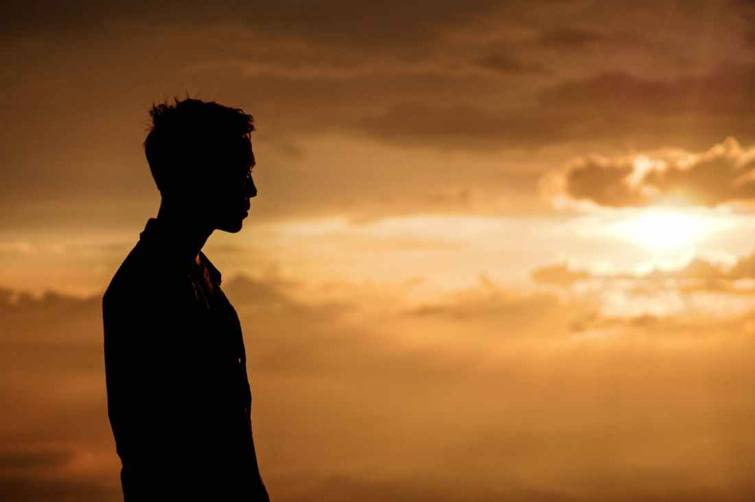 silhouette of man at sunset